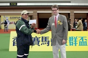 The Hong Kong Jockey Club Community Trophy Donor Mr Tobias Brown (right) presents the Best Turned Out Horse award to the winning stables assistant of Jamesina.