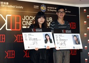 Jockey Club Cine Academy Ambassador Cheung Ka-fai (right) and young director Heiward Mak are presented with JCCA student cards to symbolise their support for the Academy.
